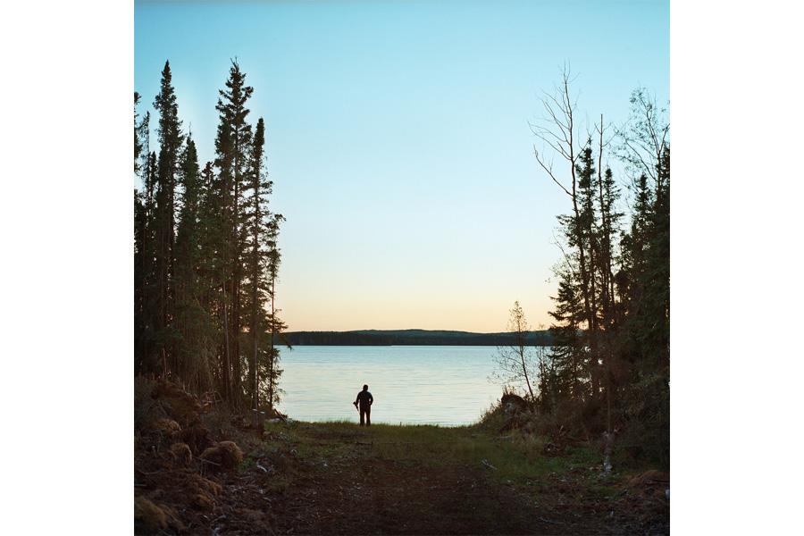 Garnet Ahyasou hunts on Fort McKay's Moose Lake (2013) by Aaron Vincent Elkaim