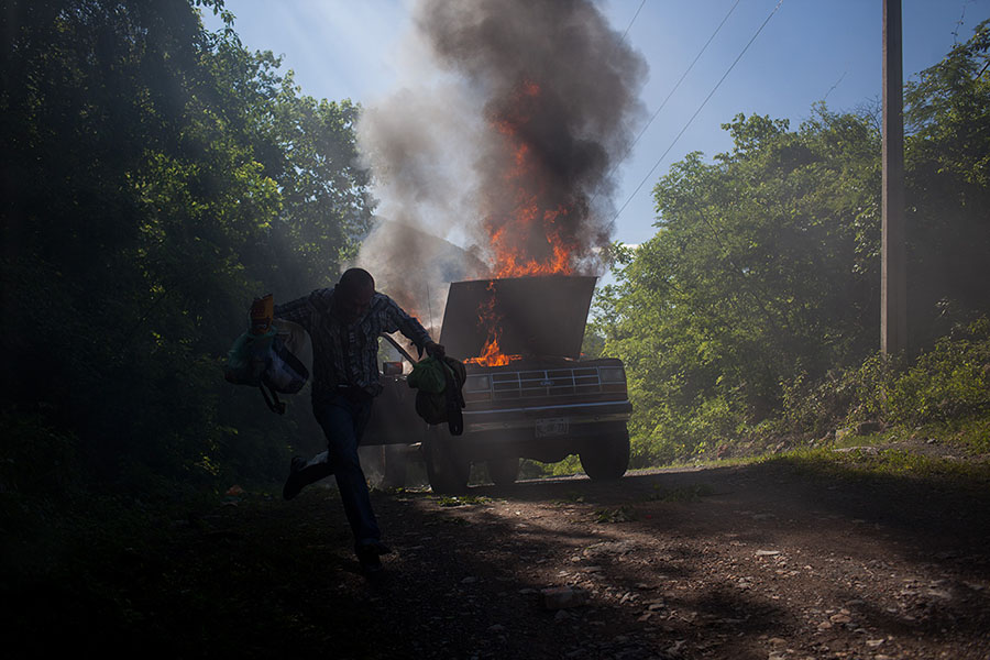 Truck Fire, Michoacán, Mexico (2013) by Brett Gundlock