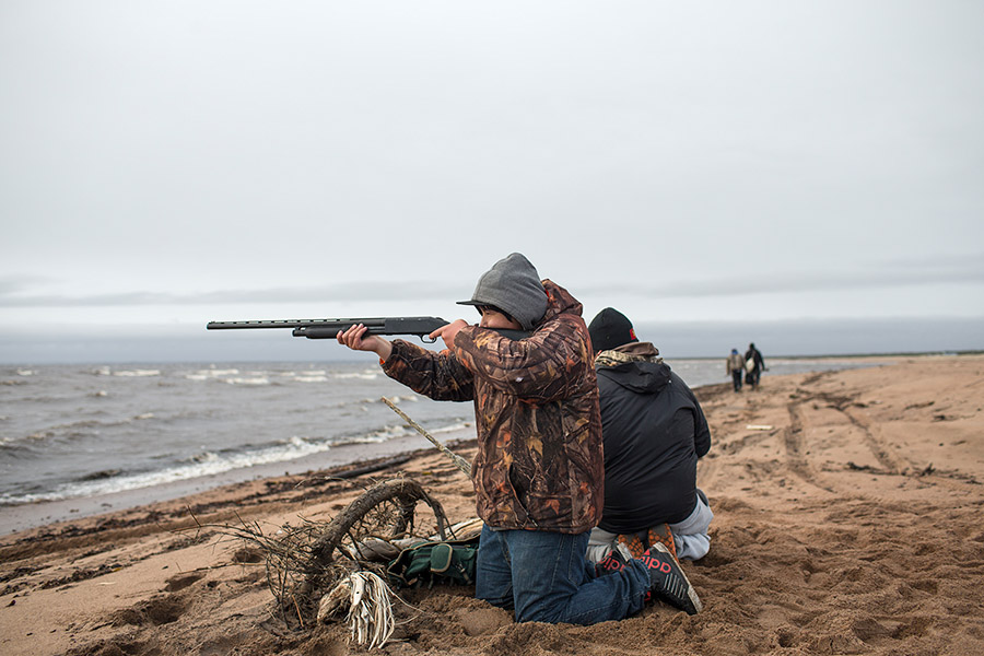 Innu boys shoot geese, Natashquan, Quebec (2013) by Johan Hallberg-Campbell