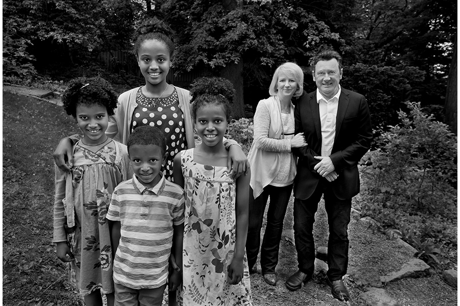 "Sara and Diarmuid O'Neill and their four children, from left Rahel, Bezawit, Selamawit and Andualem, at the family's backyard in Brookline, Mass., by Bill Brett, from ""Boston: Irish"" (Three Bean Press; 2014)"