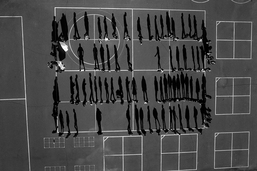 Students are seen in a schoolyard in El Dorado County, California from the series In Drones We Trust by Tomas van Houtryve/VII