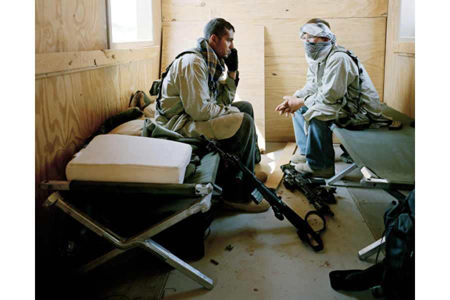 "Army Private Stephen Miller playing the role of ""Nasih Sa'd Sulaman"" and Specialist Justin Duron playing the role of ""Kameen Jubar Fawzi,"" members of the Taliban in Iraq, Medina Wasl Village, National Training Center, Fort Irwin, CA (from the series Simulating Iraq), 2008 by Claire Beckett"